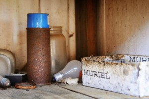 rusted spray paint blue can muriel box light bulb random stuff abandonded