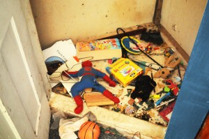 spiderman closet toys floor abandoned hangers basketball books house